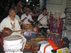 Thai buskers (I wouldn't want my Grandma doing that!)