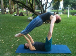 Acro Yoga in Chiang Mai park. Definitely play. (I'm the one in the air)