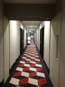 The corridor outside my Singapore room - a 70s route to infinity...it doesn't feel like party central to me...